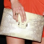 Malin Akerman Goes Exotic with a Metallic Snakeskin Clutch
