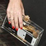 Olivia Palermo Bares It All In Charlotte Olympia Pandora Clutch