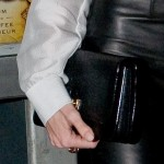 A Leather Skirt Plus A Leather Clutch Equals Angelina Jolie