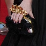 Red Carpet Trends: Emma Stone's Gorgeous McQueen Knuckle Clutch