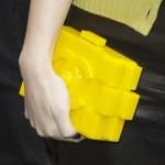 """Hailee Steinfeld Carries Geeky Chic Chanel """"LEGO"""" Clutch"""